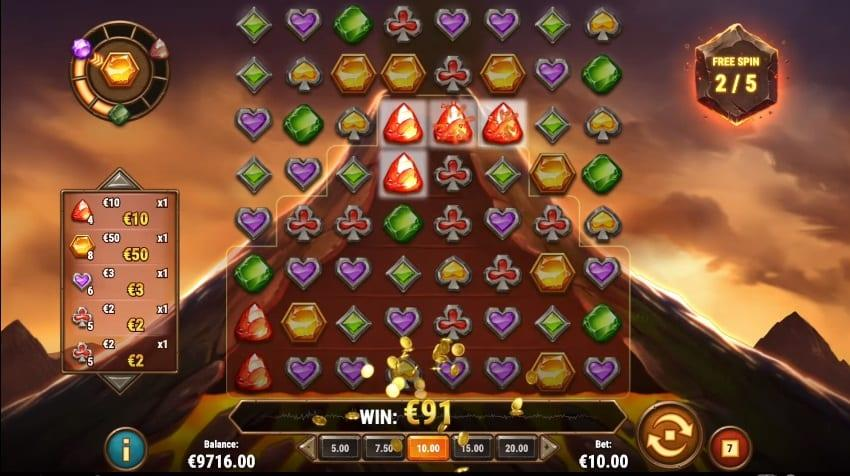 Gold Volcano Paytable: The paytable of Gold Volcano consists of 8 symbols. The high-value icons are represented by gemstones in green, red, purple, and gold.