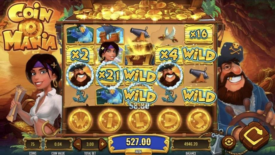 Coin O Mania Slot Symbols: This IGT title has 3 Wilds and 2 Scatters. The regular Wild is represented by a golden Wild sign, while the other two come as x2 and x21 icons.